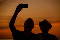 Sunset wefie (Maria Eklind) Tags: sunlight sunset nature water city vstrahamnen trdcket people clouds moln sun summer himmel siluett malm boardwalk resund vatten sundspromenaden solnedgng goodnightsun silhouette europe sky sweden skneln sverige se
