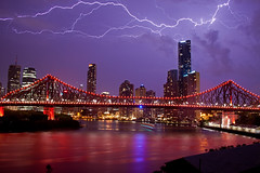 Stormy Bridge (peterreading) Tags: brisbane queensland night qld evening australia aus oz ozzie bne scenery city cityscape landscape tourist tourism pretty man manmade people bridge story storybridge road transport traffic access river water waterway buildings cbd business district skyscraper office offices apartment living work working storm weather lightning clouds brutal