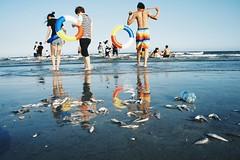 At the Beach (radtwo) Tags: shantou china beach fish sun leisure