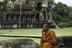 A Monk with 2 Mobiles (Simon Daniels Photography) Tags: angkor wat cambodia monk travel orange siem reap asia hindu temple monastery palace buddhist