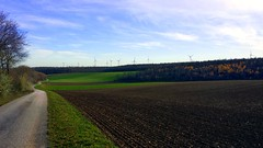 a long winding path (snowfox10) Tags: samsunggalaxys4 windmills hills autumn landscape nature field road winding