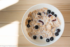 Healthy breakfast with aronia (radebg) Tags: rice bowl eating cup aronia sunny dairy cornflakes wooden table beverage milk apple breakfast healthy muesli tasty morning blue delicious drink food homemade blueberry cereal meal black spelta chokeberry juice fruit white