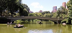 The Bow Bridge (chantsign) Tags: newyorkcity trees sky clouds skyscrapers centralpark manhattan rowing rowboat pastoral highrises bowbridge
