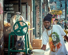 Moses makes fresh Cane Juice (Anne J Gibson) Tags: moses fujifilmxseries xpro2 fujifilmxus kensingtonlife torontostyle kensingtonmarket sugarcanejuice torontolife torontoinsta caribbean rasta marley