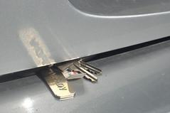 sneaky trunk keys (Justin van Damme) Tags: sneaky trunk keys gold shiny grey silver car locked found object