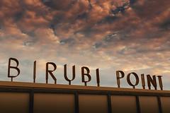 Birubi Point ('Whitewithone) Tags: australia au newsouthwales nsw portstephens annabay birubipoint birubibeach stocktonbeach beach surfclub sign clouds sky sunset