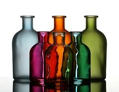 Bottle Refraction (Karen_Chappell) Tags: pink blue stilllife orange 6 white green glass bottle bottles refraction six
