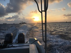 On our way back from Eneko island, sunset and tuna boats!