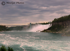 Rainbow Bridge, American Falls, and Niagara River (moelynphotos) Tags: americanfalls niagarafalls waterfalls worldfamous niagarariver powerful majestic whitewater rainbowbridge tourists riverbanks cliffs newyork ontario rapids touristdestination touristattraction northamerica boats birds cloudy internationalborder moelynphotos