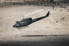 BHELMA VI AB212 (lloydh.co.uk) Tags: flying flight aviation helicopter crewman shooter spain spanish army bhelma vi as332 super puma ab212 bell helicopters lanzarote air a2a airtoair airtoairhelicopter aviationphotography bhelmavi as332superpuma bellab212 bellhelicopters airbus eurocopter