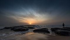 solitude (Karunyaraj) Tags: morning sea sun man water sunrise dawn solitude waves alone earlymorning sunrays chennai seashore bluetone cwc d610 breakingdawn tokina1735 chennaibeach chennaiweekendclickers nikond610 cwc540