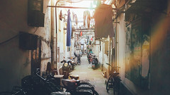 Shanghai Alley (basheertome) Tags: china summer sun lens alley shanghai motorcycles laundry flare noon