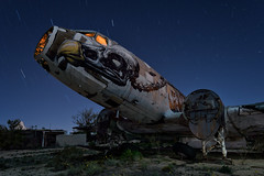 night flight. tucson, az. 2015. (eyetwist) Tags: eyetwistkevinballuff eyetwist night roa boneyardproject c47 dc3 dakota tucson arizona graffiti mural art painting boneyard airplane gooneybird skeleton buzzard beak cockpit nikkor nikon d7000 1024mm 1024mmf3545g fullmoon longexposure lightpainting moonlight npy nocturne dark desert sonorandesert rusty rust decay hulk abandoned wrecked dented metal recycling junk derelict junkyard old scrap skytrain usaf airforce cargo transport nose wings insignia faded storage amarg amarc davismonthan afb american west moon startrails nightflight graveyard military