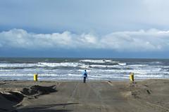 Symmetry (Jan van der Wolf) Tags: map14812v wife vrouw beach strand dustbins branding surf clouds wolken symmetric symmetry symmetrie sand zand noordwijk landscape seascape