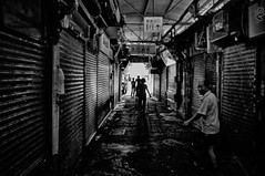 Looking for victims at the market (danigargon) Tags: white black photoshop dark walking asian photography alley nikon asia chinatown noir mood noiretblanc market victim chinese taiwan thinking taipei choosing observing dongmen  d5000 nikond5000