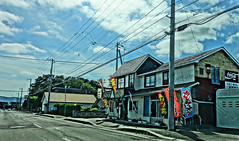 Flying Banners (sjrankin) Tags: 23july2016 edited kuriyama hokkaido japan restaurant flags banners windy wires hdr