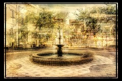 Just a Small Fountain in a Small Town (mescheibe) Tags: trees abstract blur color water beautiful modern reflections graphicdesign peace shadows florida cloudy abstractart contemporaryart contemporary surrealism digitalart surreal sunny manipulation oldbuildings photograph harmony ethereal symmetrical dreamy surrealist emotional stillness minimalistic balanced pleasant textured cubist digitalmanipulation conceptualart coordinated surrealart earthly layered intentionalblur transitional photomanipulationart