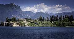 The Lake and the Mountains (Brian_Gray) Tags: italy landscape water mountains sky blue lakegarda trees treeline dolomites nikond7100 tokina1116mm sirmione