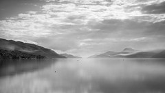 Whisp (ChrisDale) Tags: uk longexposure trees sky blackandwhite cloud sun sunlight mist lake mountains reflection beach nature water landscape grey mono mirror scotland canal highlands still haze bright scottish calm glen hills reflected highland mirrored rays loch sunrays beams lochness ness nessie caledonian dores caledoniancanal greatglen chrisdale chrismdale