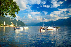 Swiss Alps and the Lake at Montreux, Switzerland (` Toshio ') Tags: summer mountain lake nature water clouds sailboat boats switzerland lakegeneva montreux swissalps lacleman toshio montreuxjazzfestival xe2 fujixe2