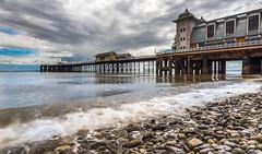 Penarth Pier (absynth100) Tags: penarth pier seascape sea wales uk seashore landscape water waves building pebbles stones reflections sky clouds