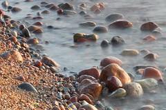 Wicie, Baltic Sea (h3rmes) Tags: sea baltic longexposure stoneswater sand beach