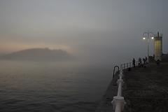 Pescando en Ribadesella (TerePedro) Tags: asturias ribadesella niebla cantbrico pesca pescador faro farola luz barandilla mar playa monte