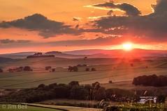 Sunset over Minninglow (itscosmicjim) Tags: sunset clouds derbyshire sunburst harboroughrocks jimbell minninglow bronzeageburialsite pentaxart