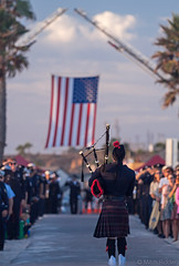 Lone Bagpiper (Mitch Ridder Photography) Tags: approved california southerncalifornia orangecounty orangecountycoast orangecountycoastline mitchridder mitchridderphotography newport newportbeach newportbeachlifeguards newportbeachlifeguarddepartment bencarlson lifeguardbencarlson newportbeachlifeguardbencarlson bencarlsonmemorial bencarlsonmemorialservice beach newportbeachfiredepartment flag bagpipe bagpiper amazinggrace