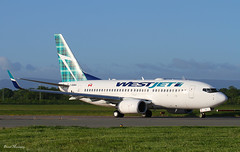 WestJet 737-7CT C-GQWJ (birrlad) Tags: ireland dublin toronto airplane design airport taxi aircraft aviation tail airplanes stjohns via landing airline 28 boeing arrival airways airlines westjet runway landed dub airliner tartan 737 arriving livery taxiway b737 737700 7377ct cgqwj