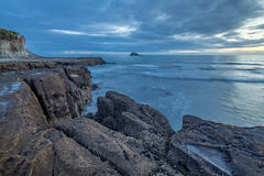 Weathered (DaveHorton_) Tags: auckland bluehour coast flatrock landscape longexposure muriwai nz newzealand sunset oaiaisland explored
