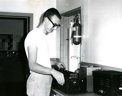 Adjusting a knob (PUC Special Collections) Tags: laboratory lab pacificunioncollege chemistrydepartment chemistrylab chemistry beakers test tubes scientist labcoat experiments angwin california adventist sda seventhdayadventist college