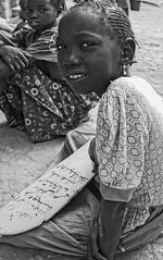 Mali, Djenné, black and white portraits #2 (foto_morgana) Tags: africa portrait people girl monochrome childhood youth child outdoor madrasah character young jeunesse stare afrika mali portret nikoncoolscan analogphotography jong djenne afrique lightroom jeugd jeune juventud blackwhitephotography persoonlijkheid karakter analogefotografie vuescan nomodelrelease caractère photographienoiretblanc kroeshaar zwartwitfotografie travelexperience quranicschool afrotexturedhair photographieanalogue editorialonly