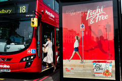 Light and Free (stevedexteruk) Tags: light free advertising yoghurt bus red london uk 2016 boarding woman marylebone road