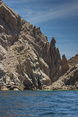 caboIMG_8811-rocks in sky (woodsongsphoto) Tags: beach beaches rock rockformations rockformation formation formations mexico mexican ocean oceans sea seas water wave waves nature natural light stone stones cabo cabos cabosanlucas explore exploring adventure adventuring travel travelling traveling tourist tour sightseeing sight see boat boats sky cloud clouds sharp blue seascape