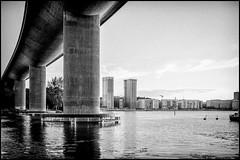 Water under the bridge (Christopher Anderzon) Tags: xf27mm xt10 fujifilm bridge water stockholm city boat ship building