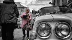 The Lady in Pink (Mark.L.Sutherland) Tags: city pink blackandwhite bw woman car closeup scotland vintagecar perspective streetphotography samsung smartphone vehicle oldlady phonecamera sutherland highstreet colorsplash coloursplash inverness selectivecolour phonography headlighs theladyinpink androidography invernessclassiccarshow galaxys5