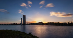 Atardecer en Sevilla... (protsalke) Tags: city longexposure sunset sky urban color clouds river relax lights sevilla guadalquivir nikon calm 9stops filternd