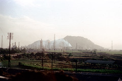 32-461 (ndpa / s. lundeen, archivist) Tags: china city winter mountain color fall film 35mm landscape nick hill chinese taiwan powerlines smokestacks kaohsiung 1970s 1972 refinery 32 taiwanese dewolf oilrefinery stanchions utilitypoles republicofchina kaohsiungcity nickdewolf photographbynickdewolf reel32
