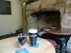 So, with an hour to spare, we headed for the pub... (pefkosmad) Tags: lambflag pub publichouse oxford oxfordshire oxon guinness wine building history old universityofoxford university stjohnscollege lastorders glass bar publicbar table