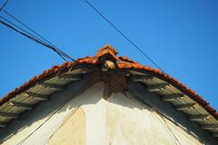 Corners II (marina_felix) Tags: sky house roof bent corner old paint chipped wall white orange blue