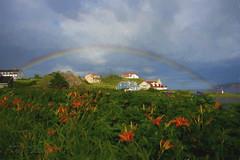Perce with full rainbow (Camerai) Tags: perce quebec rainbow flowers ocean sea clouds