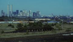 WTC 223 (stevensiegel260) Tags: worldtradecenter twintowers 1980s manhattanskyline newyorkskyline statueofliberty libertystatepark junkyard abandoned ruins