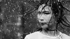 monsoon season (bis) (polo.d) Tags: rain monsoon wet water portrait outdoor face asian girl lady beauty portraiture dramatic motion drops splash artlibres