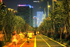 On the Lanes (Andy Brandl (PhotonMix.com)) Tags: china trees urban lines modern night pedestrians hangzhou highrises newdevelopments bingjiang runninglanes photonmix