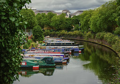 Canal life (aistora) Tags: water river canal waterway boats narrowboats boathouses vessel boat trees green reflection skyline city nature