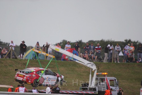 Ashley Sutton's car is recovered after a crash in the second Touring Car race during the BTCC 2016 Weekend at Snetterton