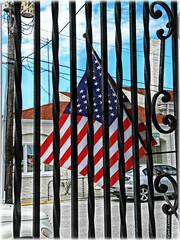 American Renaissance vs. American Annihilation (Chris C. Crowley) Tags: americanrenaissancevsamericanannihilation flagbehindbars fence gate americanflag oldglory flag bluesky myphilosophicalsemipoliticalpost