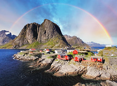 (Voyages Lambert) Tags: rockycoastline landscaped fishingvillage norwegianculture coastline lofoten cabin hut fishing arctic scenics scandinavian idyllic red blue woodmaterial cultures north architecture nature outdoors reine moskenesoya norway scandinavia europe rainbow day summer island fjord mountainpeak mountainrange mountain landscape sea water roof cottage house village town rorbu rorbuer