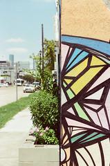 45020010 (alexdotbarber) Tags: 11000 35mm c41 danielanguilu houstonmidtown houstonstreetart kodakgold100 nikon50mmf14 nikonf nikonftnfinder slr colornegative f14 mural